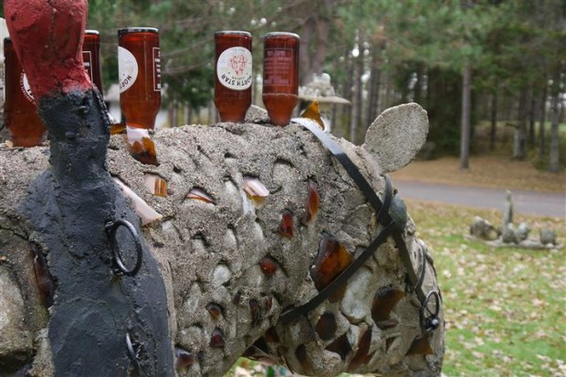 Beer bottle mane, concrete horse.