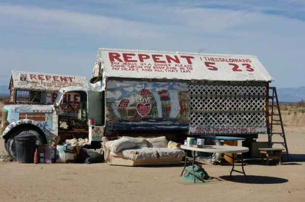 "Miscellaneous ""saved"" vehicles surround Salvation Mountain."
