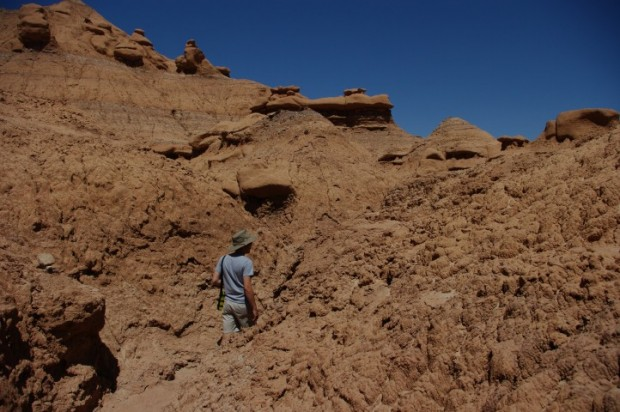 Paul on a trail through a canyon of mud.