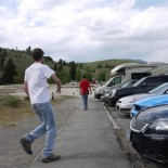 Bear spray ... never explore the parking lots of Yellowstone without it. Guy in red has a slick holster for his.