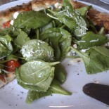 Amazing spinach and basil-topped pizza at Cafe Reyes.