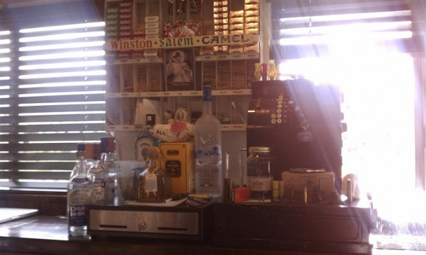 The cash register of a great bar -- note the bullets, moonshine.